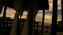 Stock footage sillowette pretty model in massage cabana-Rio De Janeiro beach Stock Footage