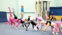 Small children doing exercises in sport and health center in Russia - stock footage