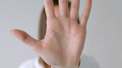 Hand reveal and conceal face Stock Footage