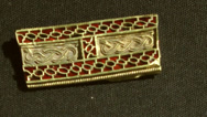 Stock Video Footage of Staffordshire Hoard Gold and Red Garnet Artifact