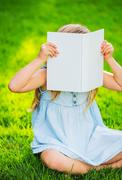 adorable cute little girl reading book - stock photo