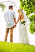 Just married couple holding hands Stock Photos