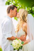 Just married couple sharing intimate moment Stock Photos