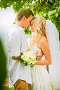 just married couple sharing intimate moment - stock photo