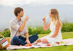 attractive couple on romantic afternoon picnic - stock photo