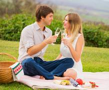 Attractive couple on romantic afternoon picnic Stock Photos