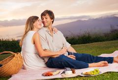 attractive couple on romantic picnic - stock photo
