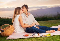 Attractive couple on romantic picnic Stock Photos