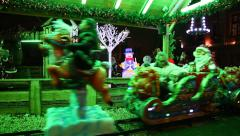 Children enjoy Christmas Luna Park train with Santa, Deer and ice man Stock Footage