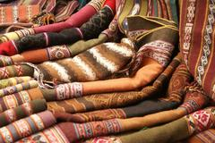 colorful handmade blankets & tablecloths, - stock photo