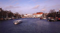 Amsterdam Holland raft, streets, canals, bridges, buildings, boats Stock Footage