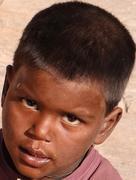 Portrait of a beggar child Stock Photos