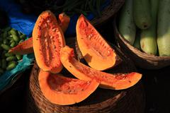 Fruit covered in flies india Stock Photos