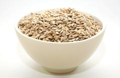 a bowl full of sunflower seeds - stock photo