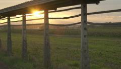 AERIAL: Old hayrack at sunset Stock Footage