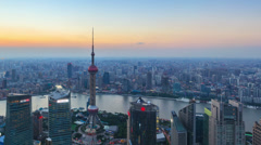 Panning TimeLapse: China Shanghai Skyline, Day to Night. - stock footage