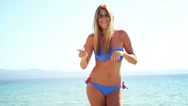 Stock Video Footage of Attractive woman in bikini dancing on a beach