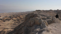 Walking on the top of Sodom Mount with view to the Dead Sea Stock Footage