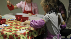 Children, parents, make gifts and toys for Christmas and New Year for joy and bu Stock Footage