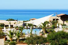swimming pool near beach at the luxury hotel, peloponnes, greece - stock photo