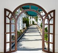 open door arch with access to the alley - stock photo