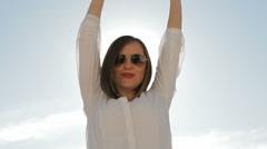 woman with sunglasses dances outdoors - stock footage