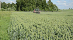Tractor equipment fertilize wheat crop plant field Stock Footage
