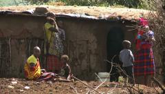 Masai women with kids in village Stock Footage