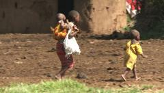 Masai children carrying each other Stock Footage