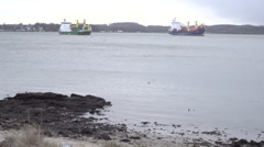 Containerboat waiting in Winter 1 Stock Footage