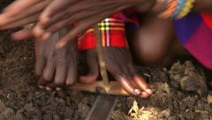 Masai traditional fire kindling Stock Footage