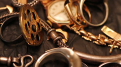 Gold jewelry consisting of chains and rings, close-up Stock Footage