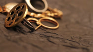 Stock Video Footage of Gold jewelry consisting of chains and rings