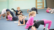 Stock Video Footage of Kids doing exercises on the lesson in acrobatics