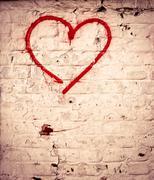 red love heart hand drawn on brick wall grunge textured background trendy str - stock photo