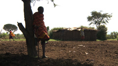 Old masai man standing in village Stock Footage