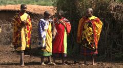 Masai women standing in village Stock Footage