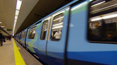 Train departing the platform in a metro station Stock Footage