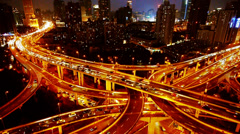 time lapse Aerial View Car Traffic Jam on overpass Interchange at night. - stock footage