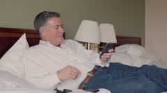 Man in a hotel room using a cell phone Stock Footage