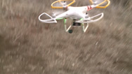 Stock Video Footage of DRONE QUAD-COPTER REMOTE RADIO CONTROLLED FLYING MACHINE