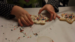 Child's hand pick up a fresh sugar cookie. Stock Footage