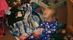 BABIES PRESENT AT CHRISTMAS - stock footage