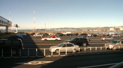Toll bridge road crossing with traffic in San Francisco bay - stock footage