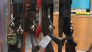 Stock Video Footage of Guns for sale on a display at the store.
