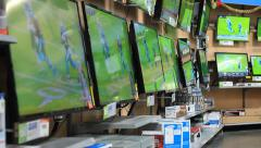 Digital Electronic Telivisions on display for sale with a football game. Stock Footage