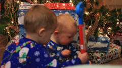 SIBLINGS CHEER UP BABY CHRISTMAS MORNING Stock Footage