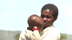 Young African mother with her child - stock footage