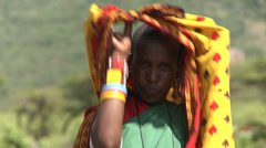 Older Masai woman with stretched earlobes 3 Stock Footage