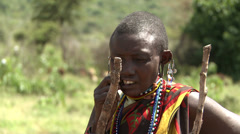 Older Masai woman with stretched earlobes Stock Footage